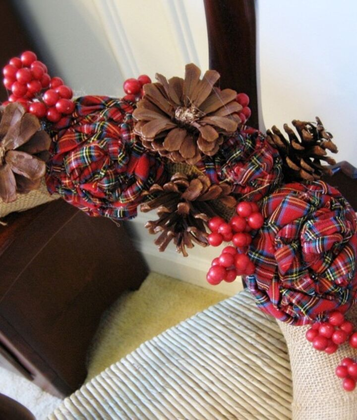 Plaid fabric roses and pine cone roses added to a simple burlap wreath
