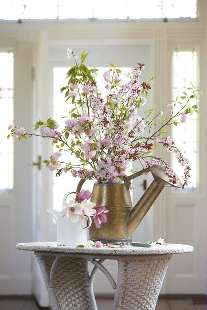 Watering cans. If you have a watering can that's seen better days, give it a new life by planting small flowers in the base of it. We're especially fond of this cherry blossom arrangement from Karin Lidbeck-Brent.
