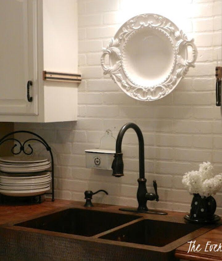 After - white painted faux-brick backsplash