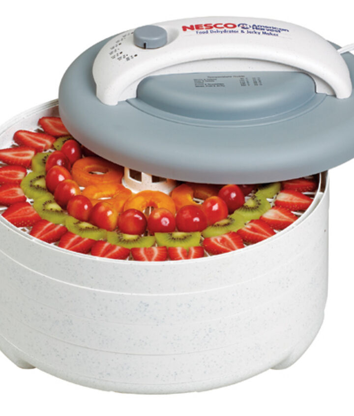 Next, I pull out my trusty food dehydrator.  I know that some people like to hang their herbs to dry.  Do this once and you will go out and purchase a food dehydrator.  I purchased mine at Walmart, but they are available at Target and Amazon.