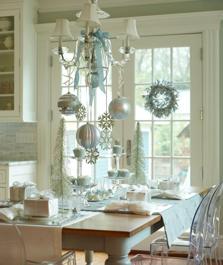 Bring out the silver and ornaments when decorating with this DIY holiday decorating idea for the chandelier!