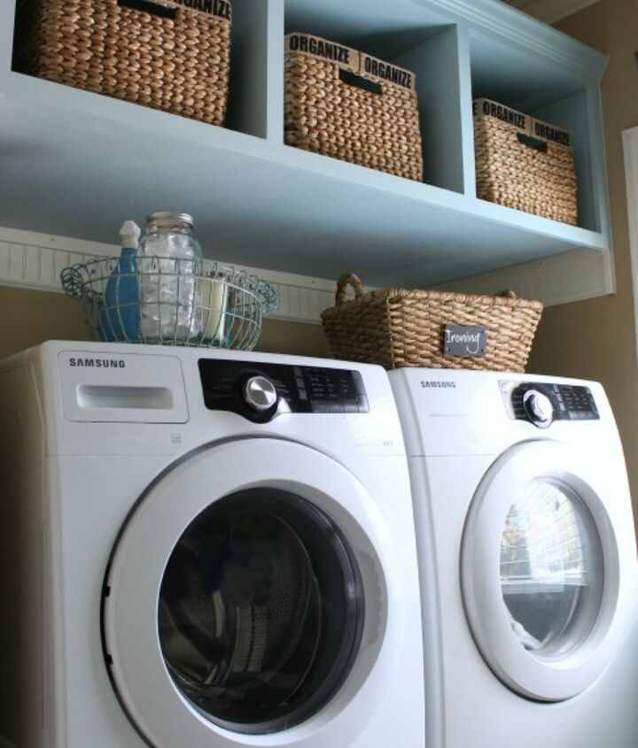 My washer and dryer sit on a beadboard-clad pedestal with room underneath for three laundry baskets. And there's more storage up top.