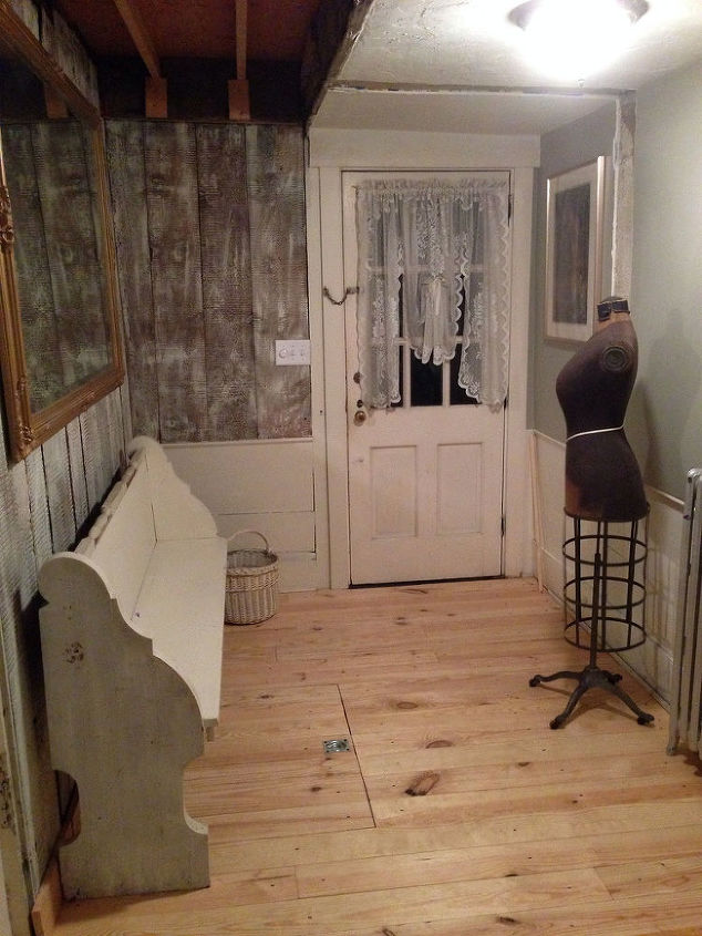 Here is the AFTER.  We had a carpenter finish the floor with some pine and he made a hatch door so we can still access the basement if we are too lazy to go outside to the bulkhead!  I still have to take down the ceiling and re-do it.