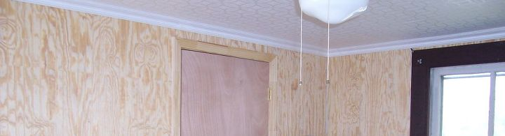 Ceiling Tiles and Moldings made this room looked finished and modern.