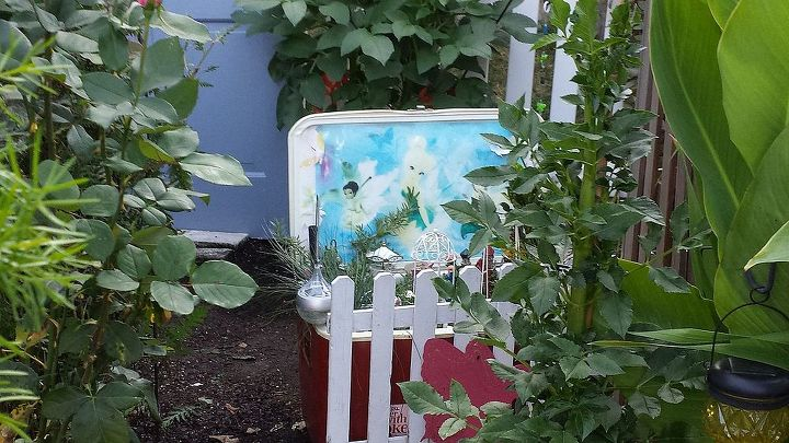 The fairy garden sits in a special place in the garden waiting to be found.  It is contained in a Cooler.