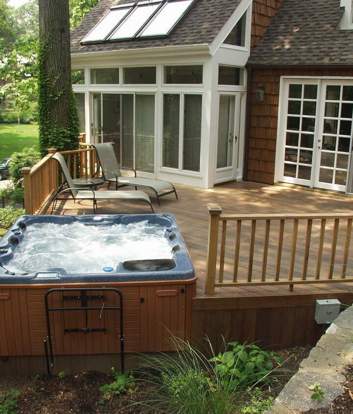 Our client had an unusable sloping rear yard. We added a mahogany deck with rails and a built in hot tub. www.longislandhottub.com