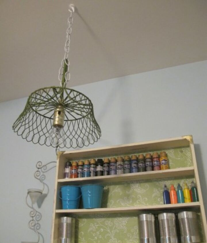 If you've got an cute (but broken) item around your house, like I had this Crate and Barrel fruit basket, you can make an upcycled pendant lamp!