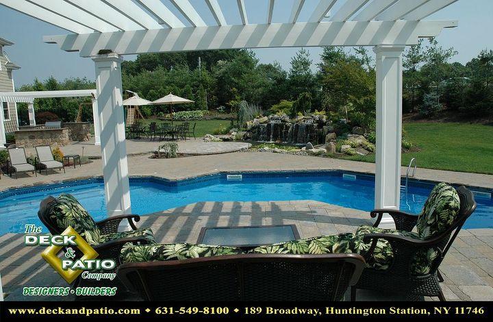 Cedar pergola painted white at raised patio on a vinyl swimming pool