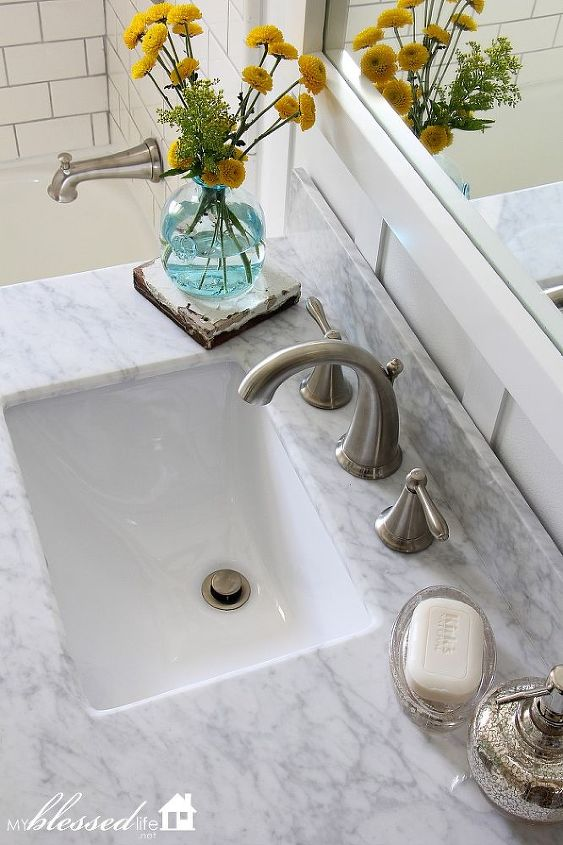 The vanity, faucet and mirror are from VirtuUSA - a wonderful company!