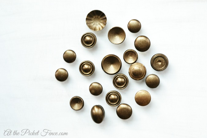 Gather together old cabinet knobs and spray paint them all the same color if you desire.