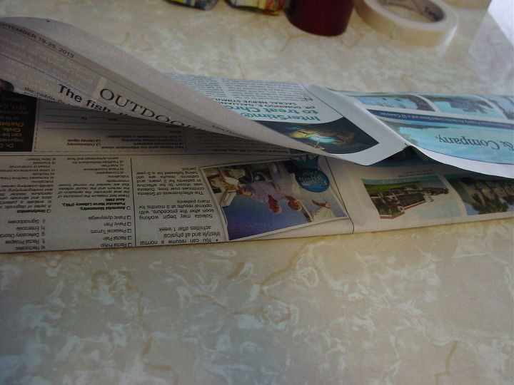 fold newspaper into thirds