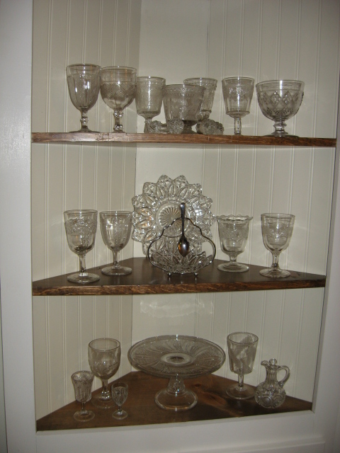 My beautiful Victorian and vintage glass collection. I can store my extras in the cabinet below!