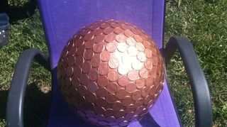 q garden ideas for bowling balls, gardening, repurposing upcycling, Penny bowling ball in the sun it shines I ve read that the pennies were left natural and allowed to develop a patina I ve also read that leaving them natural and placing them on the ground deters certain pests and good for soil