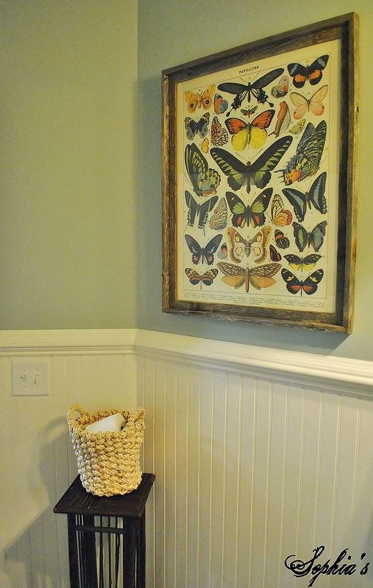 An inexpensive butterfly print framed in a barn wood frame