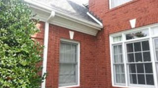 gutters around house cost, home maintenance repairs, roofing, See along garage roof front house brick for the ALSO changed a 4 inch downspout along left side to a 5 spout