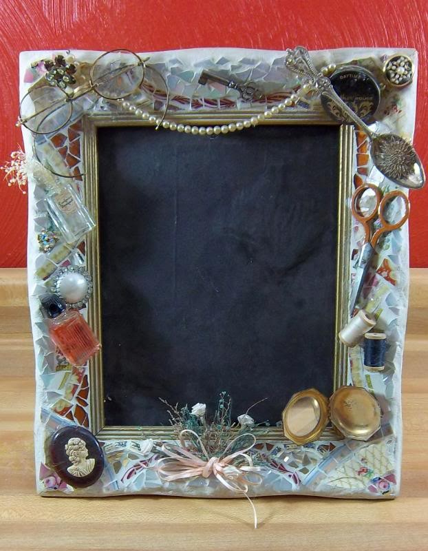 This is a Victorian Woman theme picture frame.  I bought all the objects in a box lid at an auction and decided to incorporate them into a mosaiced frame.