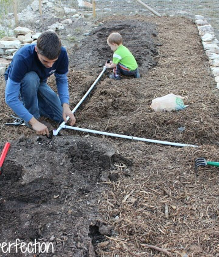never water your garden again, gardening, My brother and son adding the PVC to connect the hose to the drip irrigation