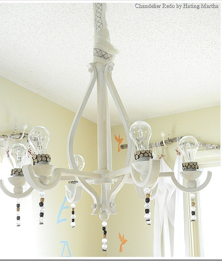 A builder grade metal chandelier was stripped down, painted, and blinged out for a special feature in the dining room!