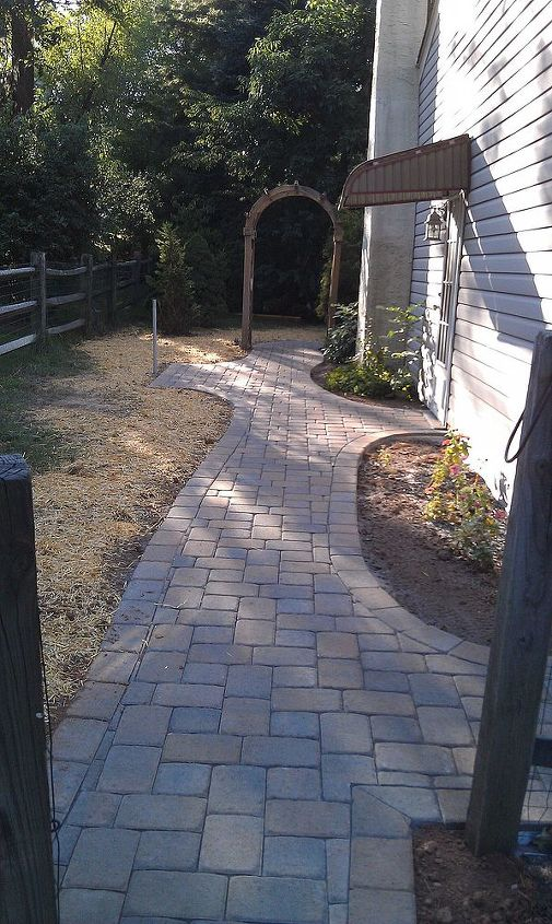 Pathway leading to patio in back of home.