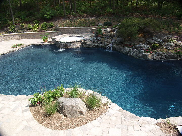Some existing landscaping was kept like this Japanese lace leaf maple over the waterfall. www.deckandpatio.com