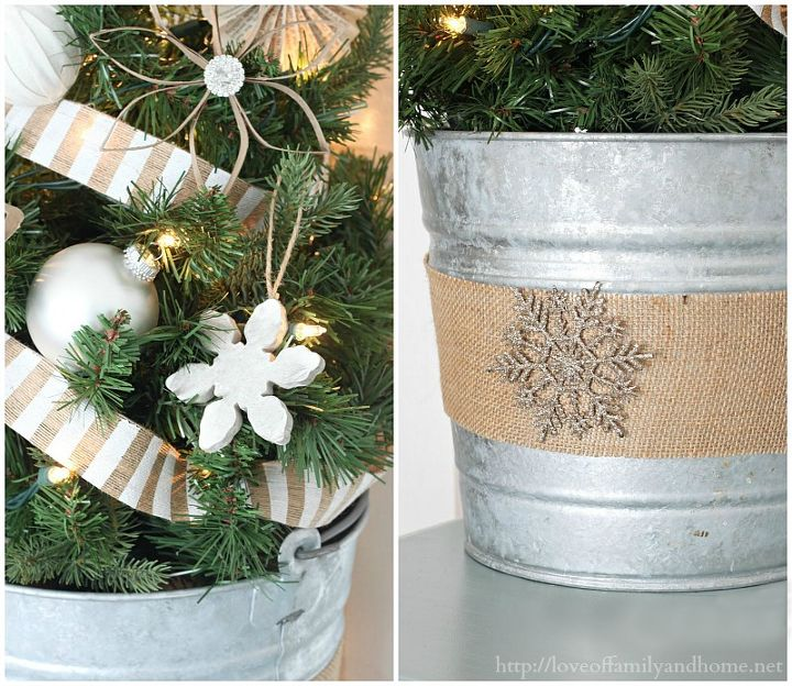 I decided that the tin bucket the tree was in needed a little sprucing, so I added a strip of burlap to it & hot glued a snowflake ornament on it for a little added bling!