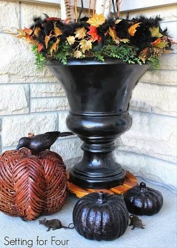 Fun black urn & pumpkins at  Setting for Four.