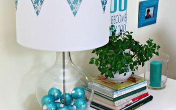 decorate a fillable glass lamp for the holdays, home decor, lighting, Lamps filled with ornaments and shade decorated with snowflake bunting