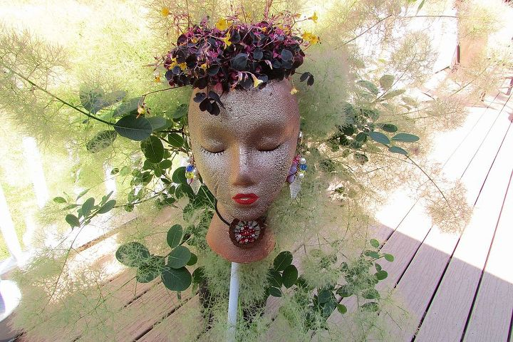 This lovely young lady is ready to add a touch of beauty to any garden.