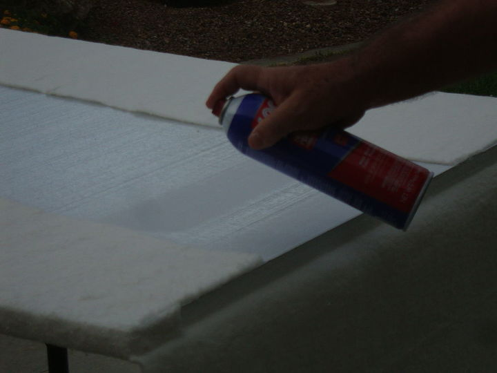 Then used spray adhesive to attach the batting to the back of the boards.