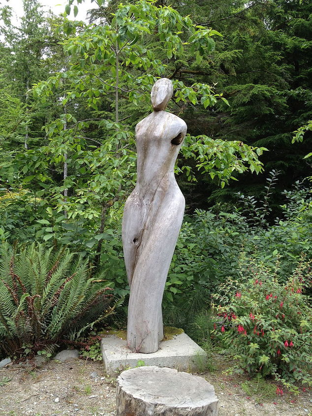 This driftwood girl is located at the botanical gardens in Tofino...except for the head it was formed by the waves....beautiful:)
