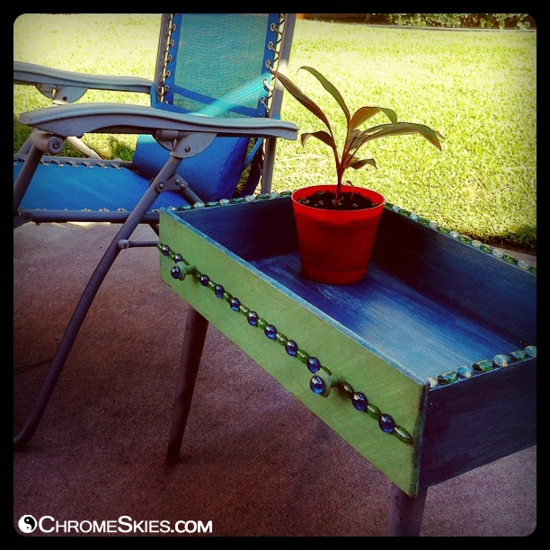 Turn an old drawer into a handy patio table!  http://chromeskies.com/blog/2013/04/repurposed-dresser-drawer-into-baubled-patio-table/