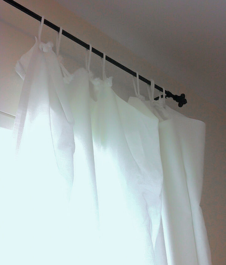 The curtains were white twin sheets with homemade tabs. A cut down laundry line was cut into pieces, knotted then hand stitched onto the sheets. Simple, casual and pretty!