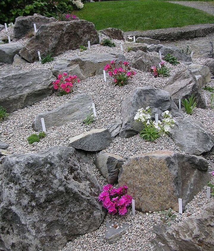 Checking out other rock gardens gave us ideas on what we wanted in our new rock garden. Here scree is used in this garden.