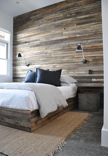 reclaimed wood wall. bedroom. wall sconces. modern rustic.