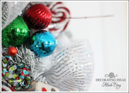 I used mesh ribbon, and shatter proof ornaments.