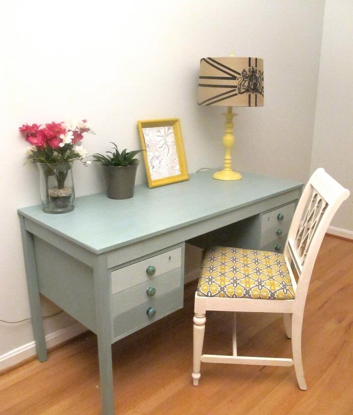 Everything you see in this pic was second-hand! The desk was from the dumpster...the chair, lamp, picture frame, and flower pots, came from the thrift store! :) This is where I do all my blogging, too!