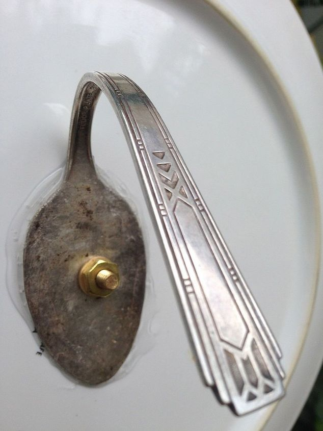 Used the flattened spoon method to hang this plate & it's much easier & faster than the bell. I glued with Plumbers GOOP & put screw thru front plate then thru spoon with nut attached.