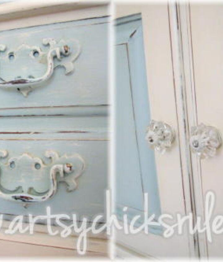 Painted and distressed with matching painted hardware and new glass knobs