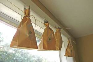 harvesting and preserving herbs, gardening, Bag drying place bunched herbs in a paper bag and tie closed Hang the bag upside down on an indoor clothesline pegs nails or drying rack in a dry location
