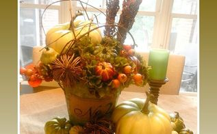 a rusty metal bucket with a burlap numbered patch makes a beautiful fall, seasonal holiday decor