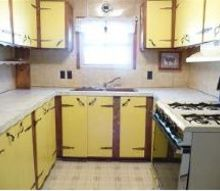 trailer kitchen renovation, home decor, kitchen design, before a single light over the window questionable yellow cabinets messed up wall covering