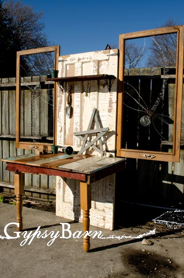 Old door, fence boards, table legs, two old screen window frames, left over electric fence wire (the large dragonflies) and two drawer pulls to hang your towels and tools on