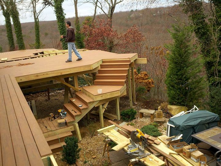 "Trick: Plan the deck, this staircase ""hugged"" the deck so it would not interfere with the patio below. http://www.deckandpatio.com/decks/portfolio.html"