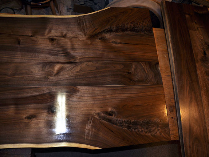 l shaped walnut slab desk, painted furniture, woodworking projects, Got a few costs of finish on there the little piece to the right in this pic will get swung 180 degrees and connect to the straight part at the bottom right of the big slab dowels and sash locks to be able to take it apart