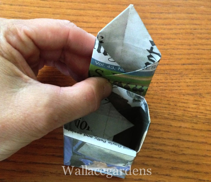 Then do the same thing on the right side, reversing the crease. You now have a pointed tab on top, which you will fold into the center, tucking the point into the bottom of the pot.