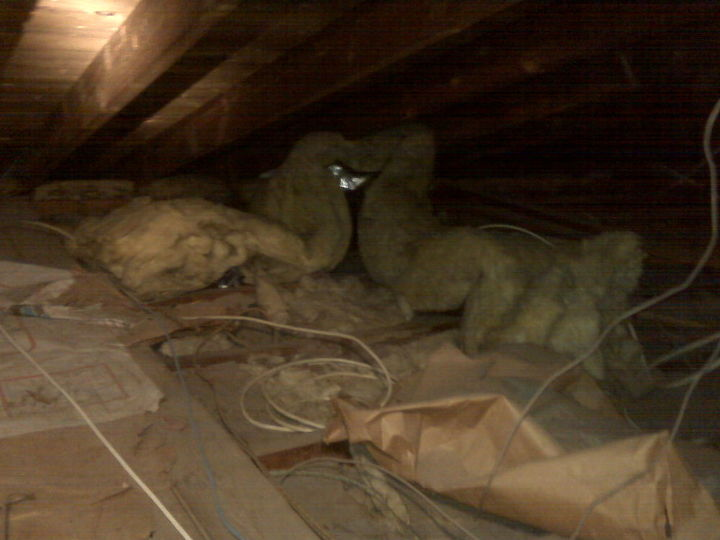 Notice the paper backed insulation. This is kindling for the light fixtures that overheat and spark because of poor wiring practices found in this attic