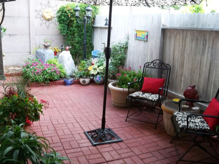 Back patio with our smaller fountain in the flower bed