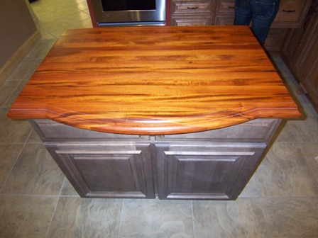 "AK is actually selling this heirloom quality kitchen island.  Wellborn Forest 39"" Peninsula Cabinet in 'Spanish Moss' with stunning Tigerwood Top with Roman Ogee Edge. Asking $1000 & it's available for pick-up in Marietta!"