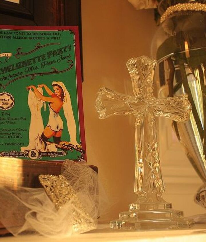 A crystal cross, one of my own wedding gifts, some more tulle, and the invitation to her bachelorette party also decorated the mantel.