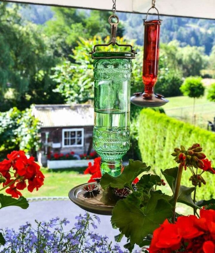 The bottle styled hummingbird feeders are right at home among all the flowers.